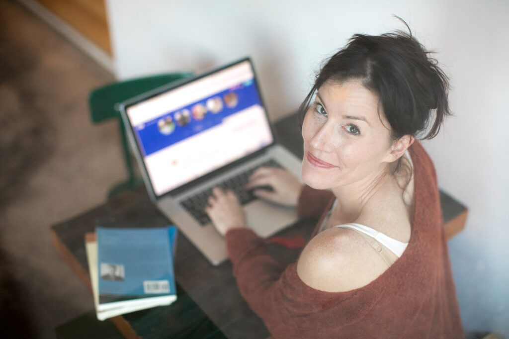 Woman surfing looking at an online dating profile.
